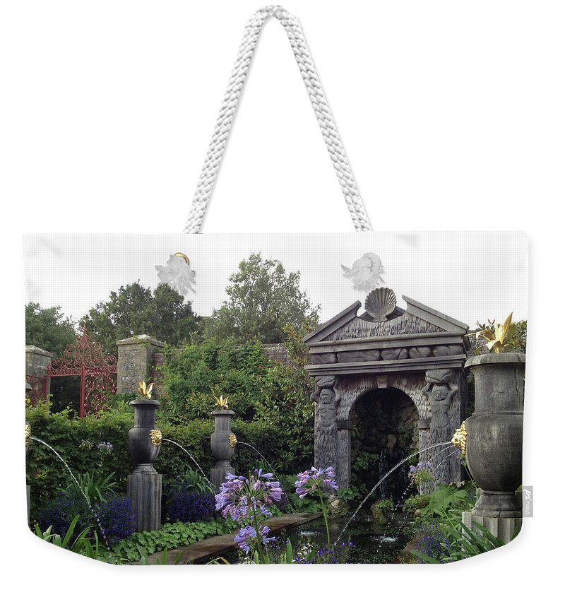 Photograph Weekender Tote Bag featuring the photograph Fountain Garden by Nicole Parks