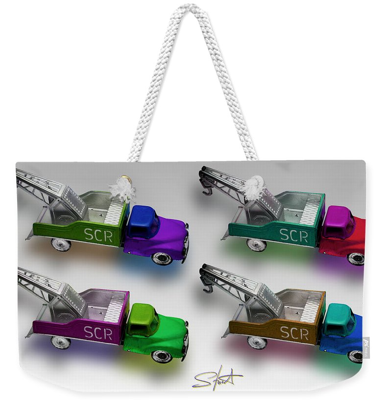 Toy Weekender Tote Bag featuring the photograph Four By Four by Charles Stuart
