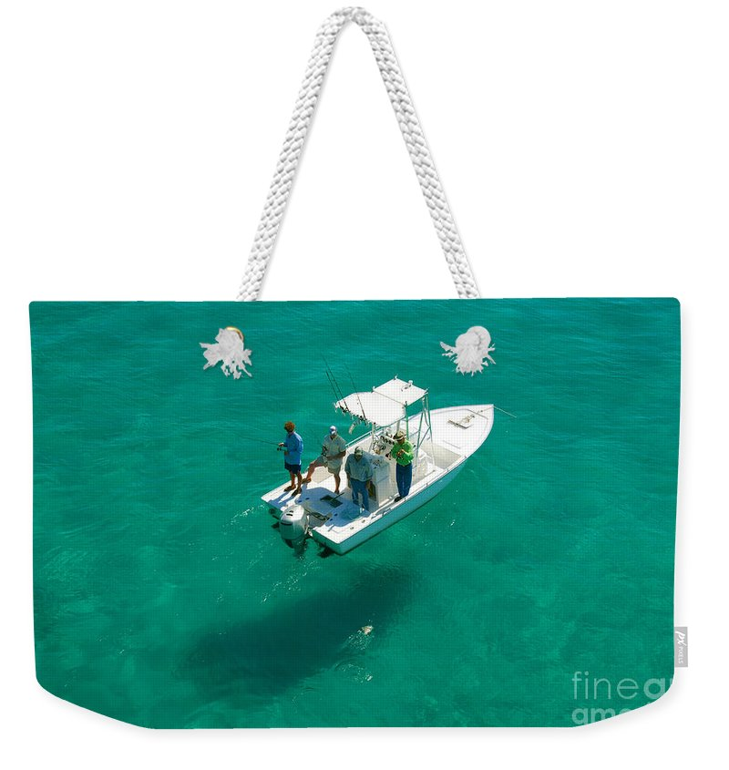 Fishing Weekender Tote Bag featuring the photograph Four Fishermen by David Lee Thompson