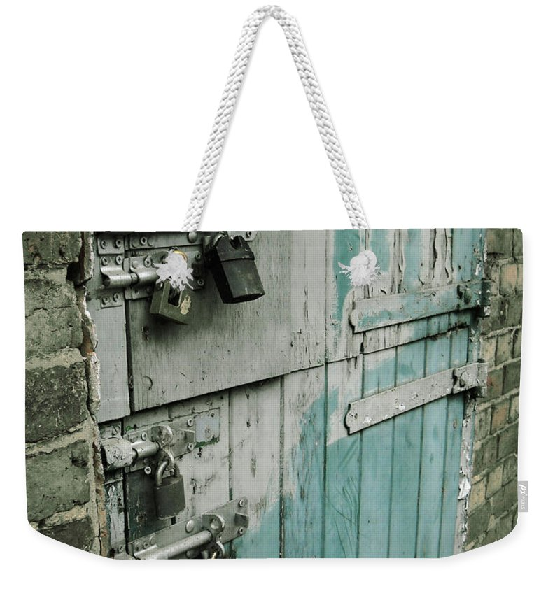 Photo Weekender Tote Bag featuring the photograph Four Latches by Julia Raddatz