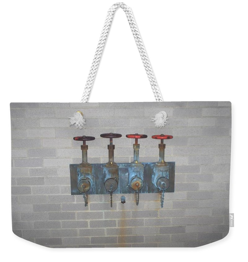 Photograph Weekender Tote Bag featuring the photograph Four Pipes by Thomas Valentine