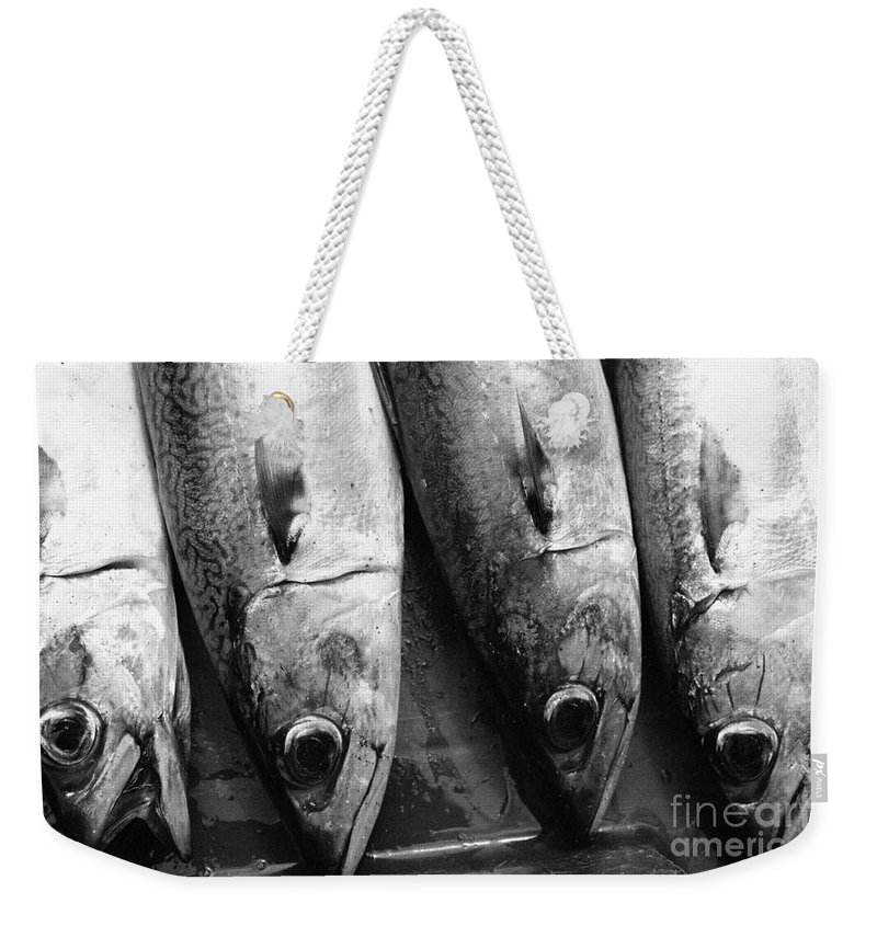 Black And White Weekender Tote Bag featuring the photograph Fresh Catch by Gaspar Avila