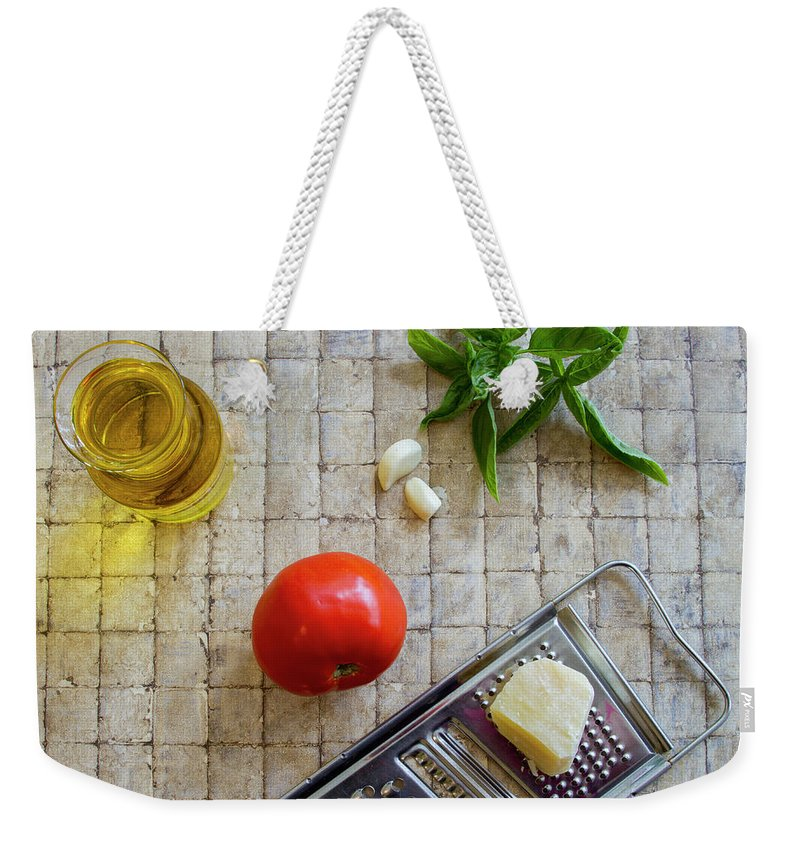 Basil Weekender Tote Bag featuring the photograph Fresh Italian Cooking Ingredients On Tile by Karen Foley