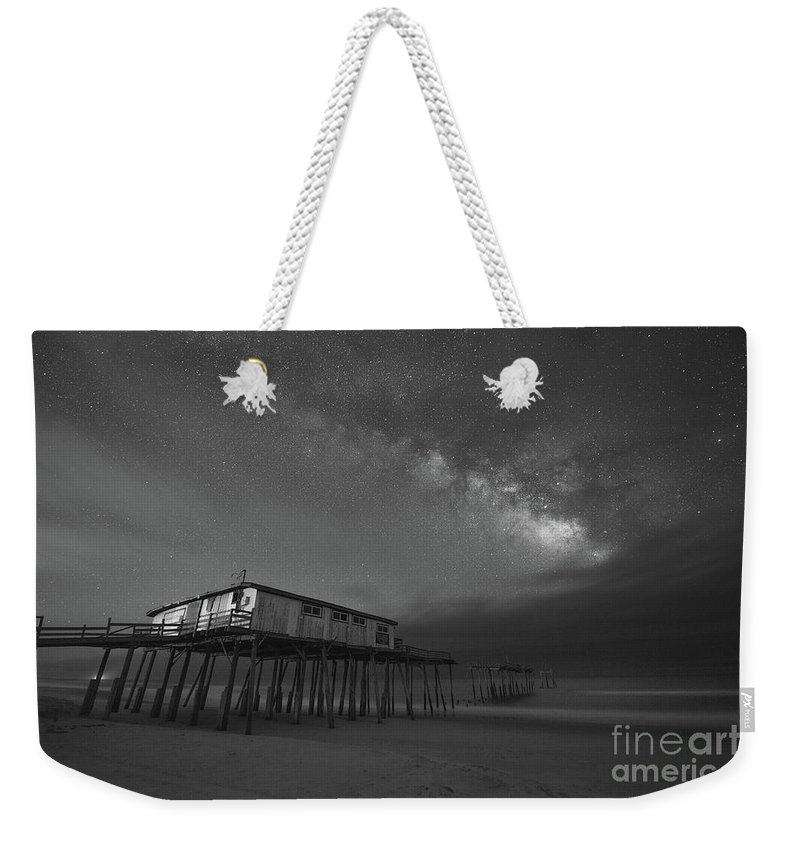 Frisco Pier Weekender Tote Bag featuring the photograph Frisco Pier Under The Milky Way Bw by Michael Ver Sprill