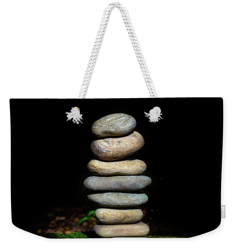 Zen Stones Weekender Tote Bag featuring the photograph From The Shadows by Marco Oliveira