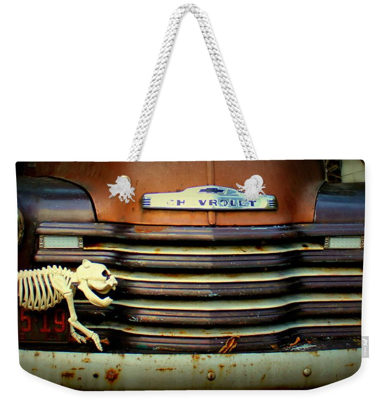 Old Weekender Tote Bag featuring the photograph Front End Grille Of 1953 Chevrolet Advantage Design Truck With Dog Skeleton by Anita Hiltz