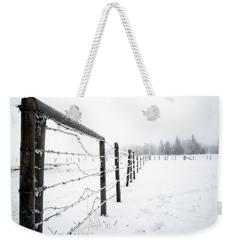 Landscapes Weekender Tote Bag featuring the photograph Frosty Fenceline by Shelly Priest