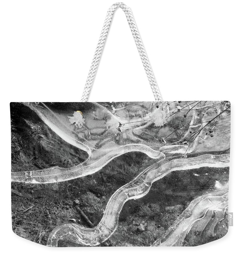 Abstract Weekender Tote Bag featuring the photograph Frozen Puddle by Lyle Crump