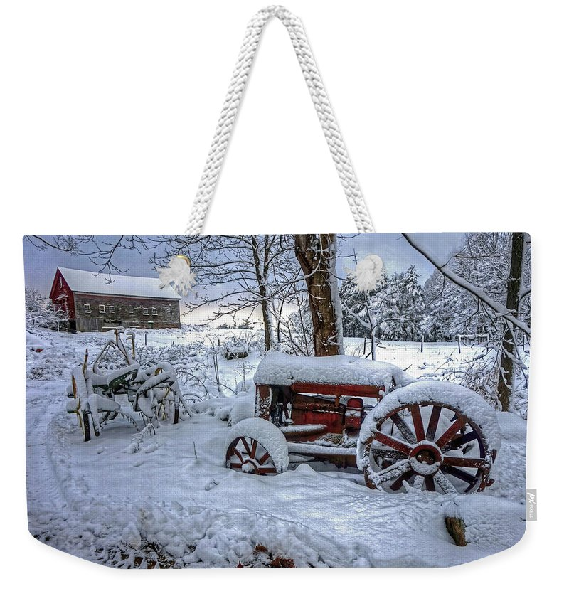 Farm Tractor Winter Snow Barn Antique Weekender Tote Bag featuring the photograph Frozen Relics by Wayne Marshall Chase