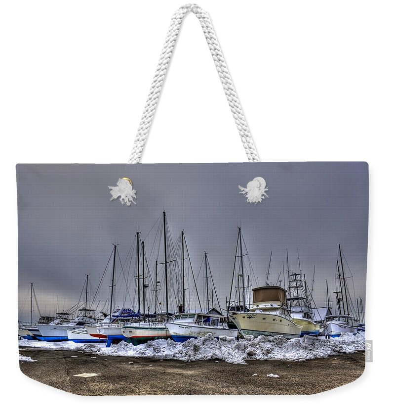 Boat Weekender Tote Bag featuring the photograph Frozen Waves by Evelina Kremsdorf