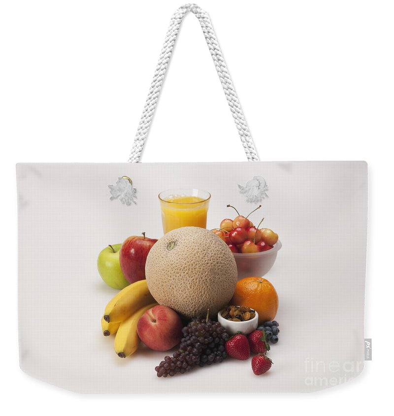 Orange Juice Weekender Tote Bag featuring the photograph Fruits by George Mattei