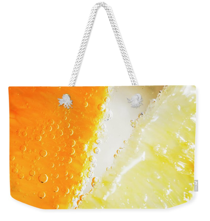 Slice Weekender Tote Bag featuring the photograph Fruity Drinks Macro by Jorgo Photography - Wall Art Gallery