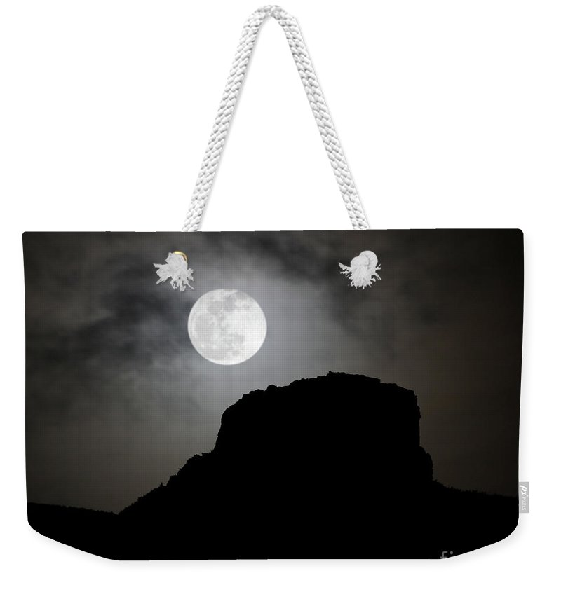 Castle Rock Weekender Tote Bag featuring the photograph Full Moon Over Castle Rock by Andrew Terrill