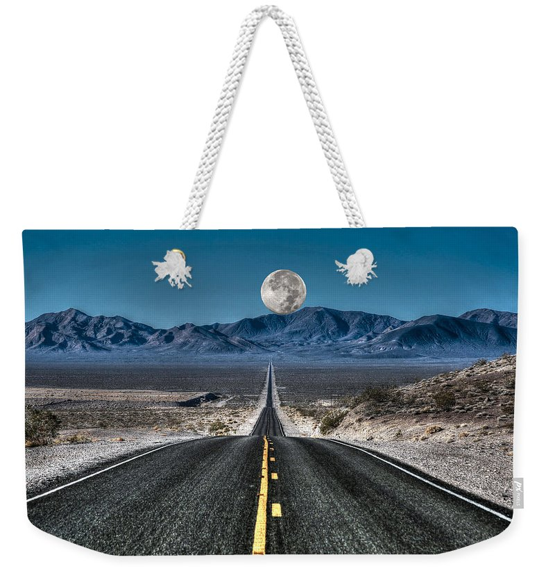 Road To Nowhere Weekender Tote Bag featuring the photograph Full Moon Over Death Valley by Donna Kennedy