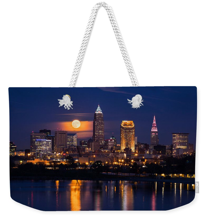 Full Moonrise Over Cleveland Weekender Tote Bag featuring the photograph Full Moonrise Over Cleveland by Dale Kincaid