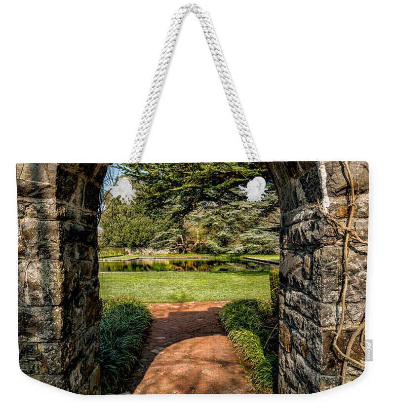 Garden Weekender Tote Bag featuring the photograph Garden Archway by Adrian Evans