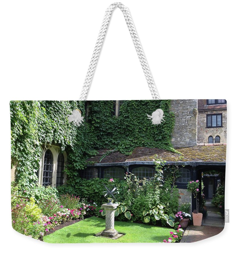 Photograph Weekender Tote Bag featuring the photograph Garden Globe by Nicole Parks