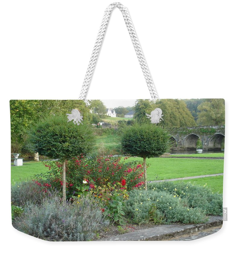 Inistioge Weekender Tote Bag featuring the photograph Garden On The Banks Of The Nore by Kelly Mezzapelle