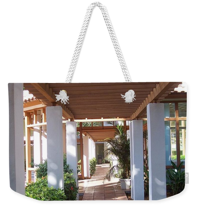 Garden Weekender Tote Bag featuring the photograph Garden Pillars by Erica Degni