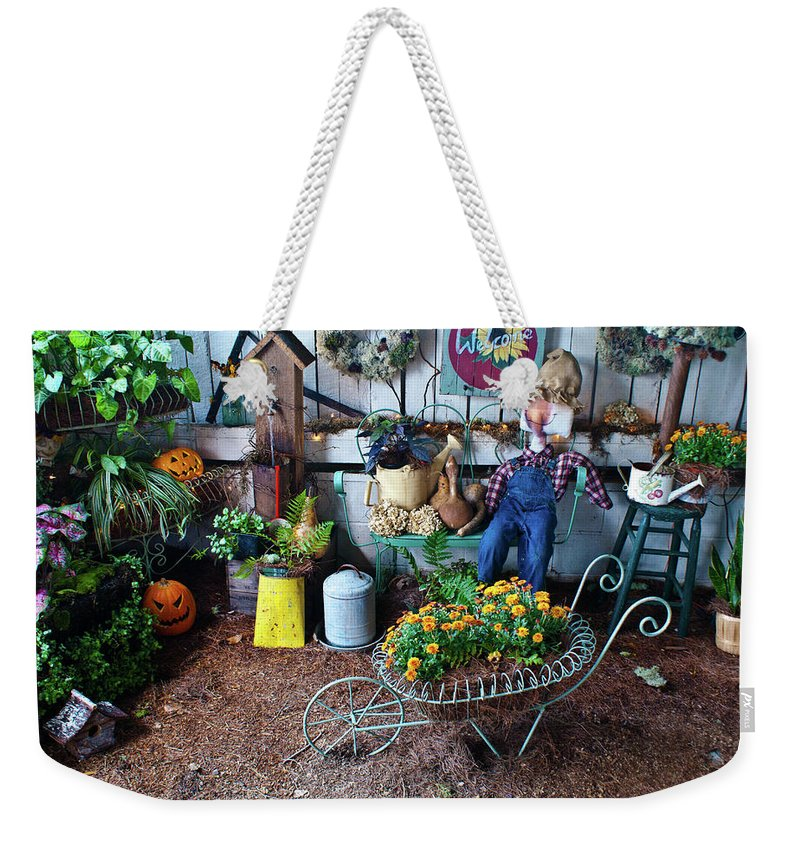 Gardeners Weekender Tote Bag featuring the photograph Gardeners Delight by Douglas Barnett
