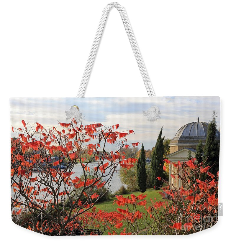 Garrick Temple On The River Thames At Hampton Schumach Red Leaves Tree Weekender Tote Bag featuring the photograph Garrick Temple On The River Thames At Hampton by Julia Gavin