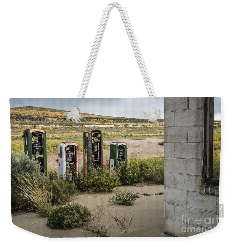 Gas Station Relics Weekender Tote Bag featuring the photograph Gas Station Relics by Priscilla Burgers