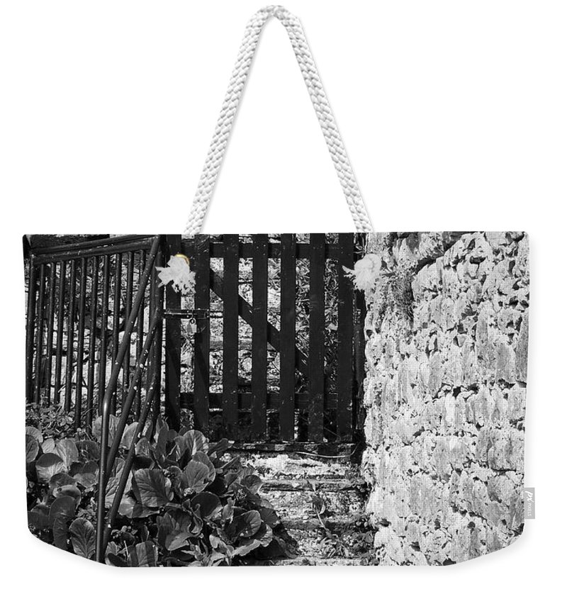 Irish Weekender Tote Bag featuring the photograph Gate At Dunguaire Castle Kinvara Ireland by Teresa Mucha