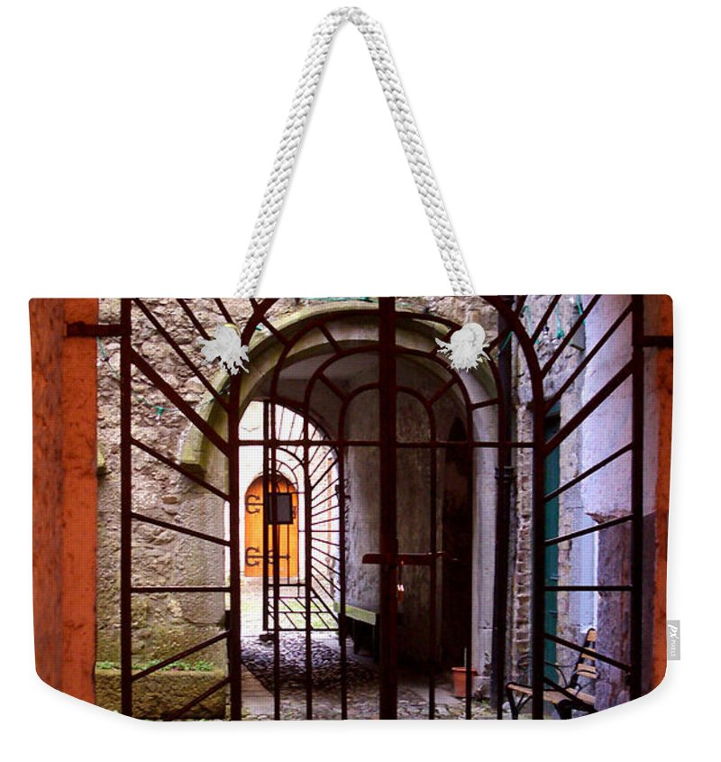 Gate Weekender Tote Bag featuring the photograph Gated Passage by Tim Nyberg