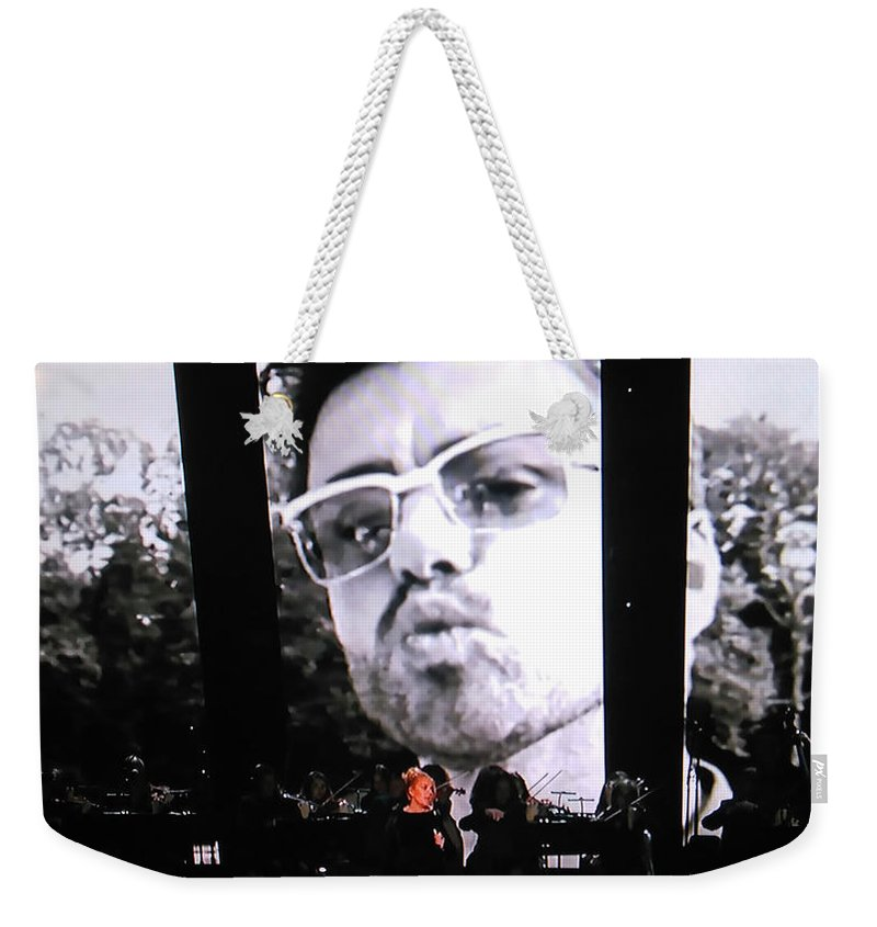 George Michael Weekender Tote Bag featuring the photograph George Michael Sends A Kiss by Toni Hopper