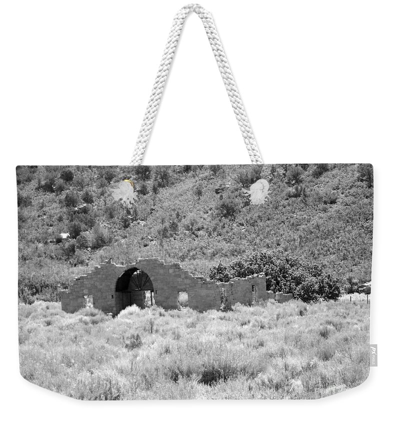 Gateway Weekender Tote Bag featuring the photograph Ghost Of Colorado by Tommy Anderson