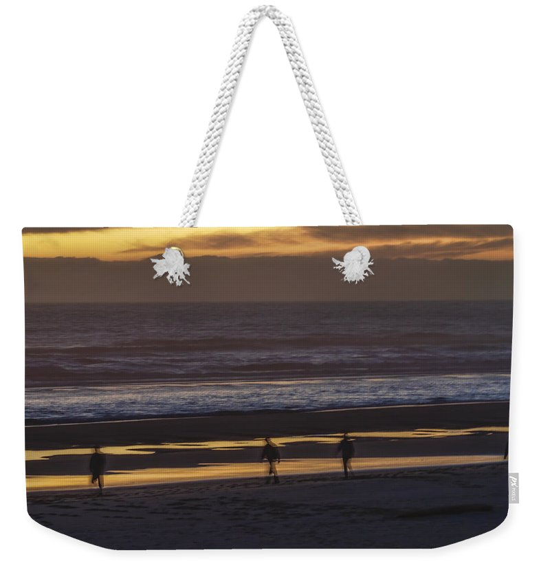 Sunset Weekender Tote Bag featuring the photograph Ghostly Sunset Walk by Lindley Johnson