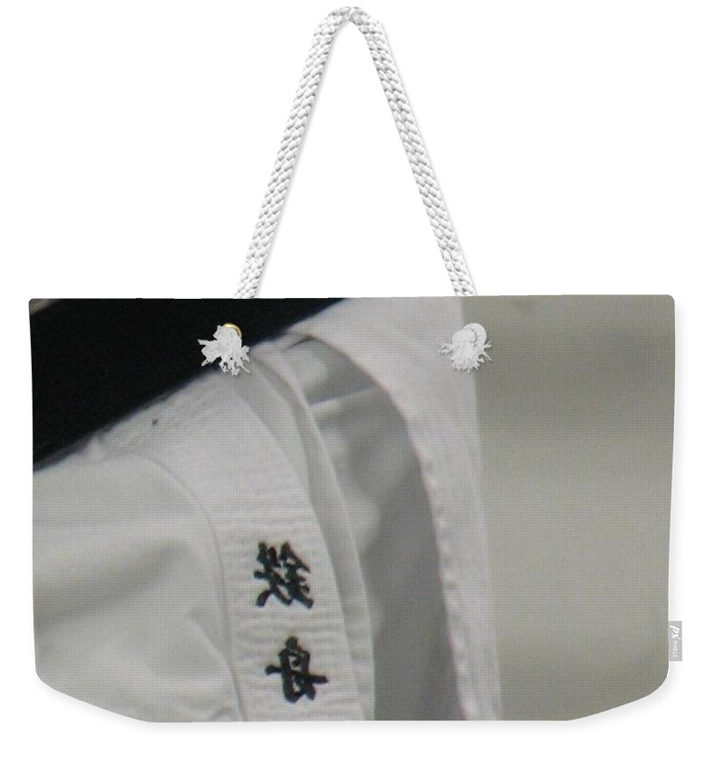 Karate Weekender Tote Bag featuring the photograph Gi by Kelly Mezzapelle