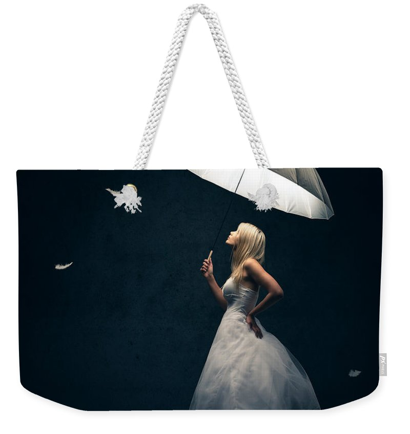 Girl Weekender Tote Bag featuring the photograph Girl With Umbrella And Falling Feathers by Johan Swanepoel