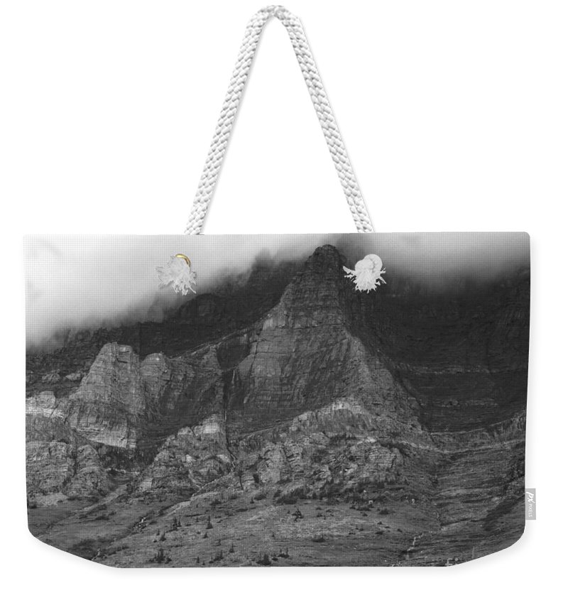 Glacier National Park Montana Horizontal Black And White Mountain Cloud Landscape Striation Pine Tree Waterfall Weekender Tote Bag featuring the photograph Glacier National Park Montana Horizontal by Heather Kirk