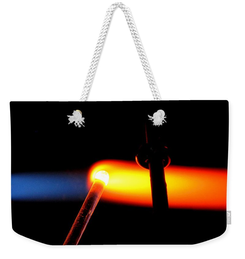 Flame Weekender Tote Bag featuring the photograph Glass Bead Making by Sarah Houser