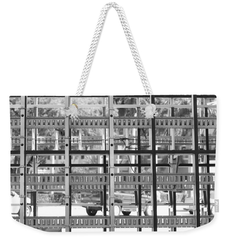 Black And White Weekender Tote Bag featuring the photograph Glass Holders by Rob Hans