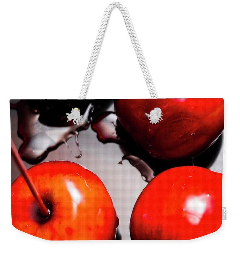 Apple Weekender Tote Bag featuring the photograph Gleaming Red Candy Apples by Jorgo Photography - Wall Art Gallery