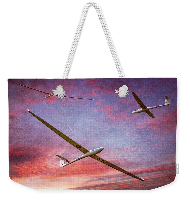 Glider Weekender Tote Bag featuring the photograph Gliders Over The Devil's Dyke At Sunset by Chris Lord