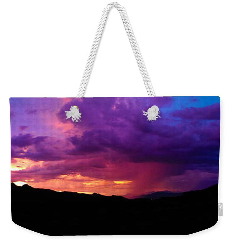 Sunset Weekender Tote Bag featuring the photograph Globe Sunset by Erica Raymond