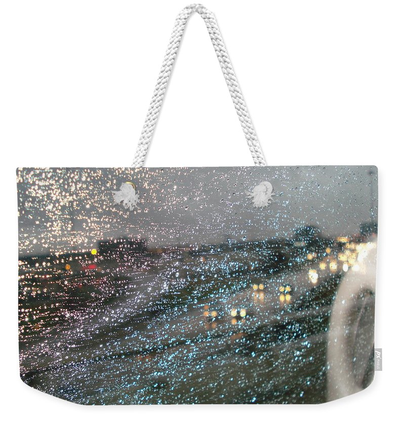 Usha Weekender Tote Bag featuring the photograph Glowing Raindrops In The City by Usha Shantharam