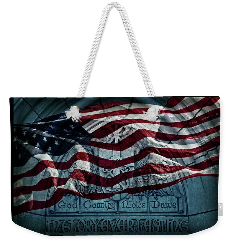 Notre Dame Weekender Tote Bag featuring the photograph God Country Notre Dame American Flag by John Stephens