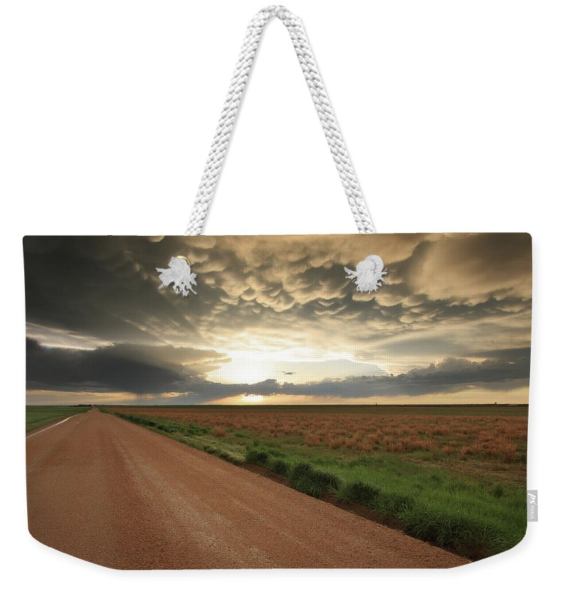 Sunset Weekender Tote Bag featuring the photograph God's Way Of Calling It A Day by Brian Gustafson