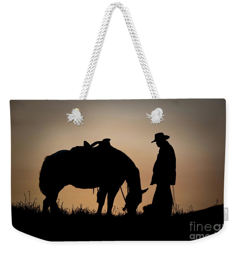 Cowboy And Horse Weekender Tote Bag featuring the photograph Going Home by Sandra Bronstein