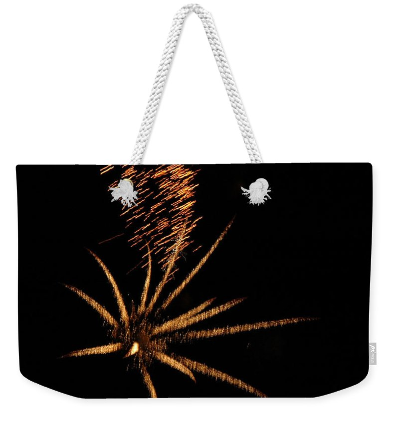 Fireworks Weekender Tote Bag featuring the photograph Gold Star Tail by Norman Andrus