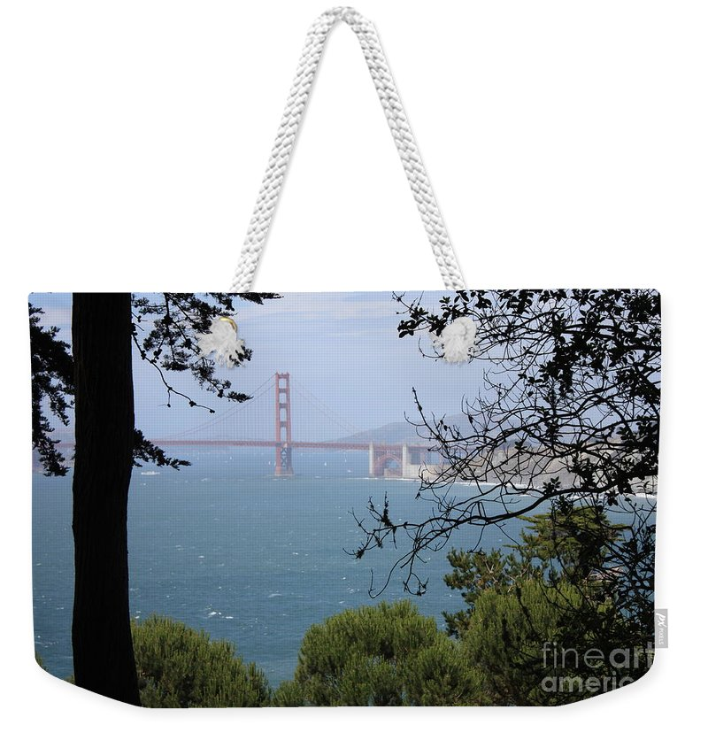 San Fancisco Weekender Tote Bag featuring the photograph Golden Gate Bridge Through The Trees by Carol Groenen