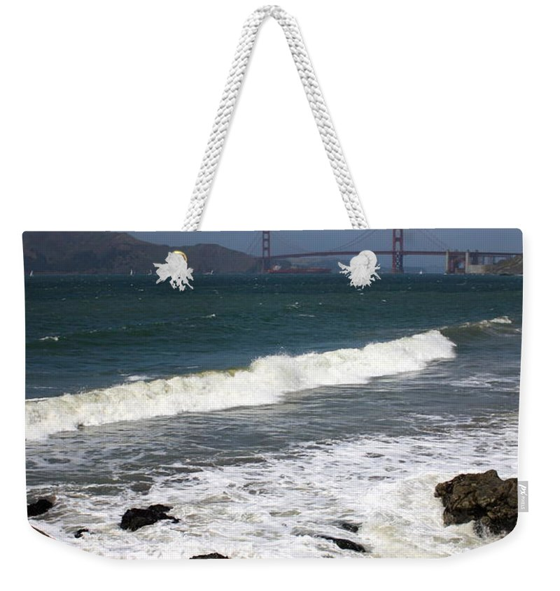 San Francisco Weekender Tote Bag featuring the photograph Golden Gate Bridge With Surf by Carol Groenen