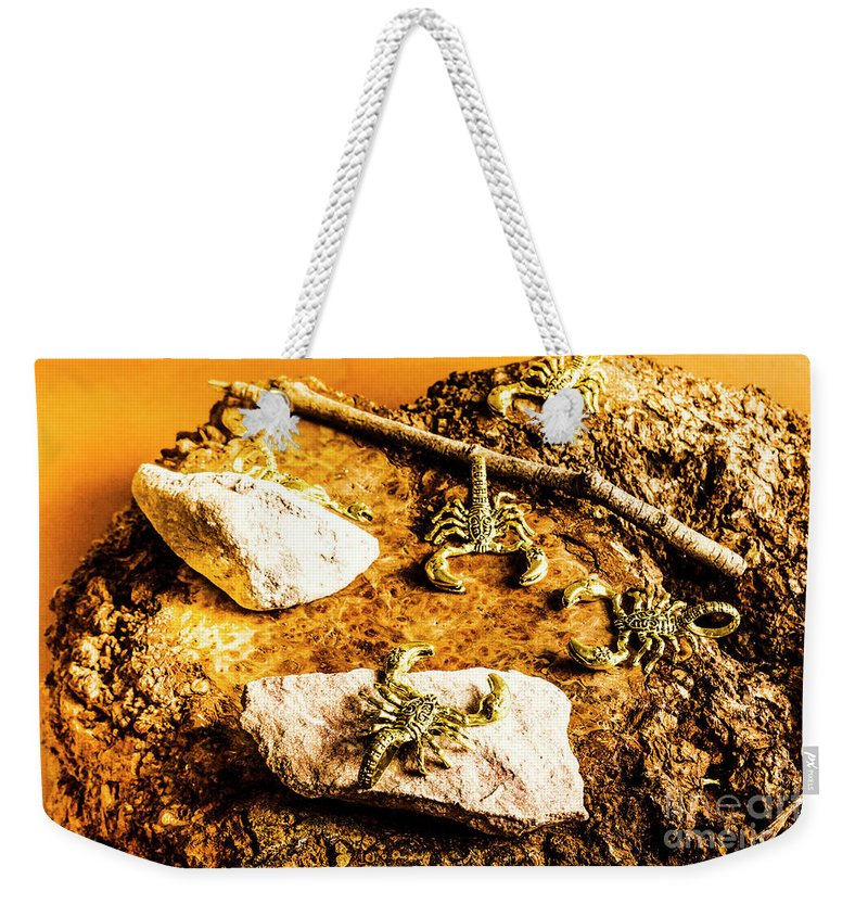 Scorpio Weekender Tote Bag featuring the photograph Golden Scorpion Amulets by Jorgo Photography - Wall Art Gallery