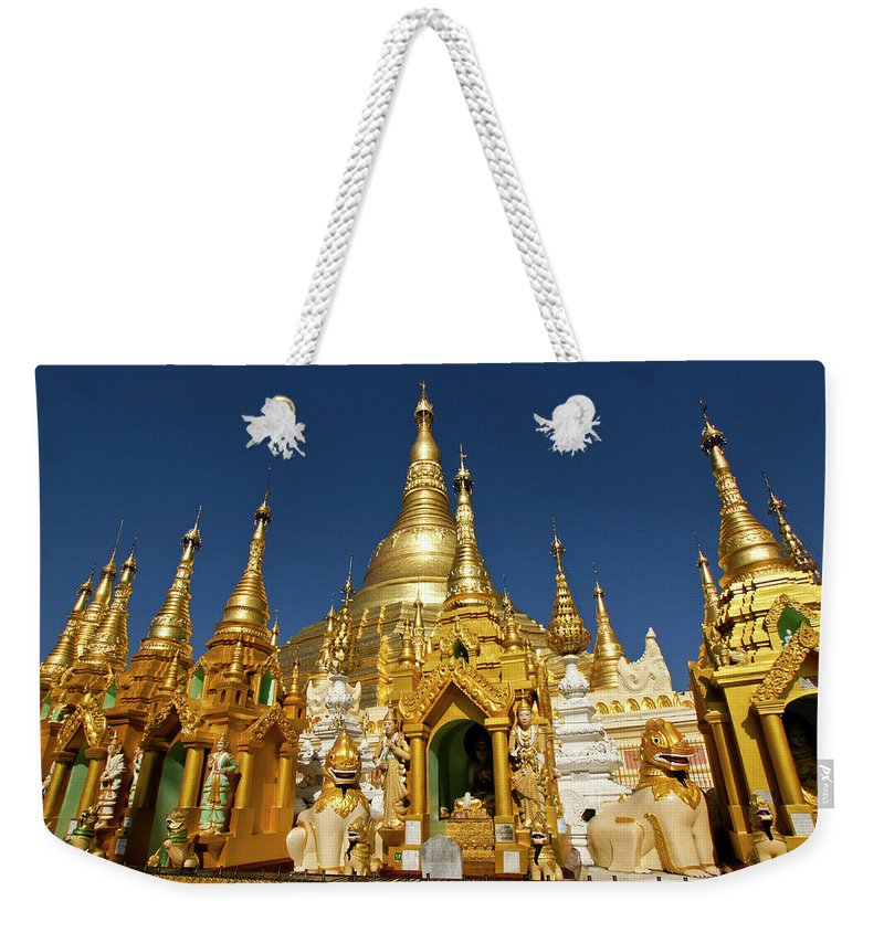 Asia Weekender Tote Bag featuring the photograph Golden Spires by Michele Burgess