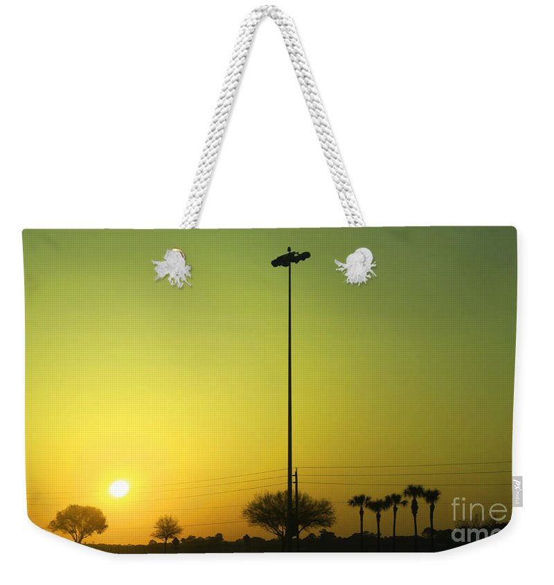Golden Weekender Tote Bag featuring the photograph Golden Sunrise by Deborah Benoit