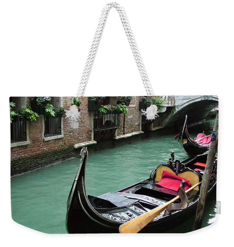 Venice Photos Weekender Tote Bag featuring the photograph Gondola By The Restaurant by Donna Corless